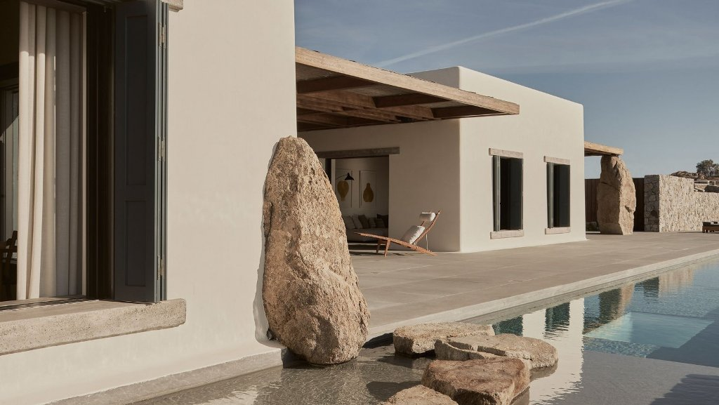 Real rocks are incorporated into the design of the house