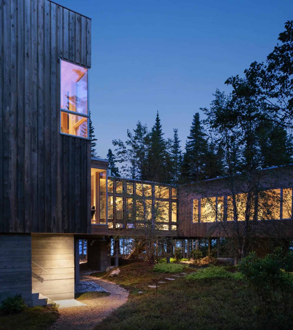 The exterior of the cabin is clad in wood which has a beautiful weathered patina
