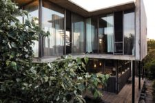02 The house features much weathered wood and concrete, and it opened to outdoors