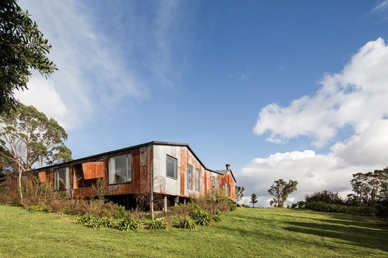 The house is situated on a rural Chilean island and is surrounded by nature and farms