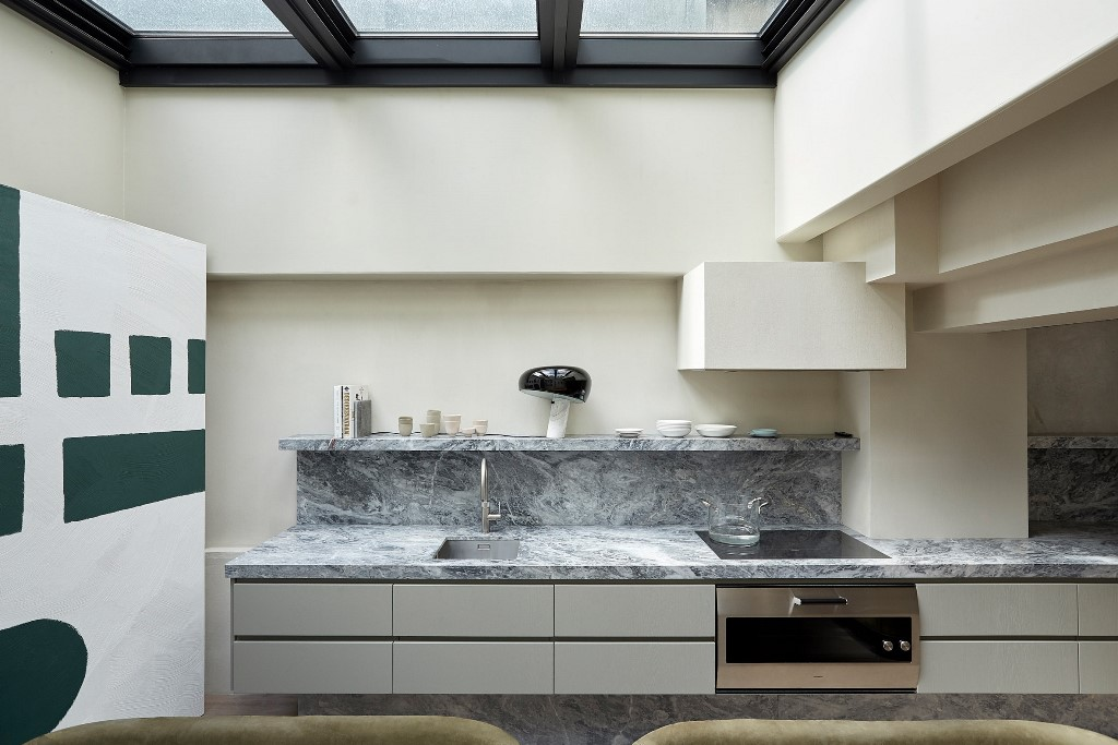 The kitchen is done with a marble backsplash, a glass roof that can be opened to outdoors anytime