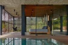 03 The spaces are indoor-outdoor, with a pool and a deck to which the indoor spaces open