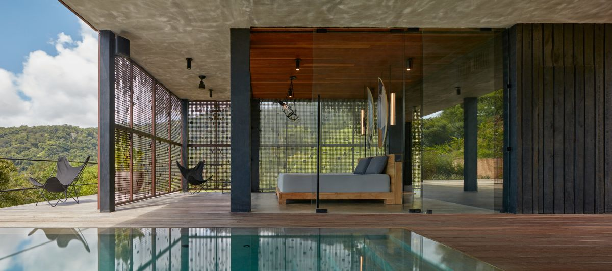 The spaces are indoor outdoor, with a pool and a deck to which the indoor spaces open