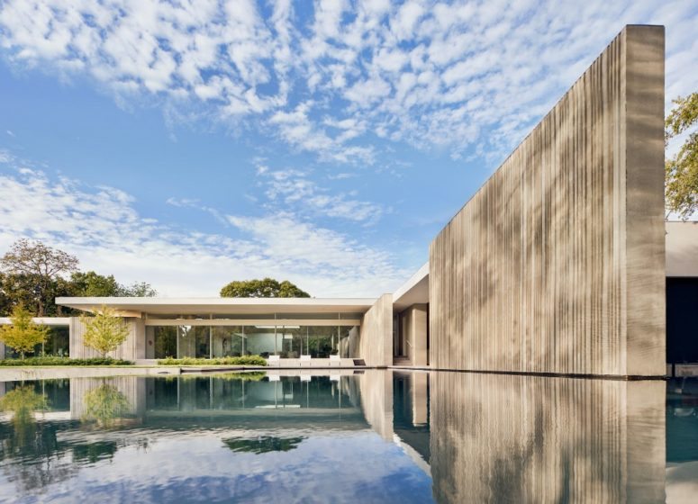 There's a large pool next to the house, and it softens the brutal look of the walls