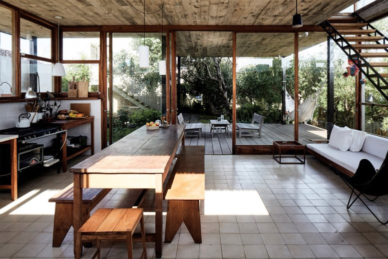 The kitchen is fully glazed and feels indoor-outdoor thanks to its design and not much furniture