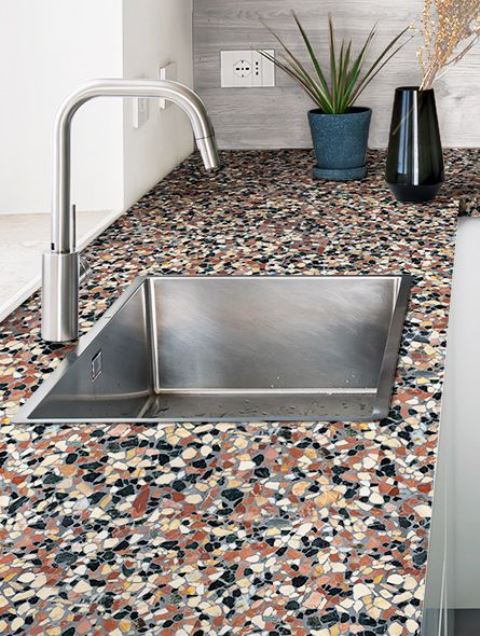 such a super bright terrazzo countertop will make any kitchen, even the most neutral one, stand out a lot
