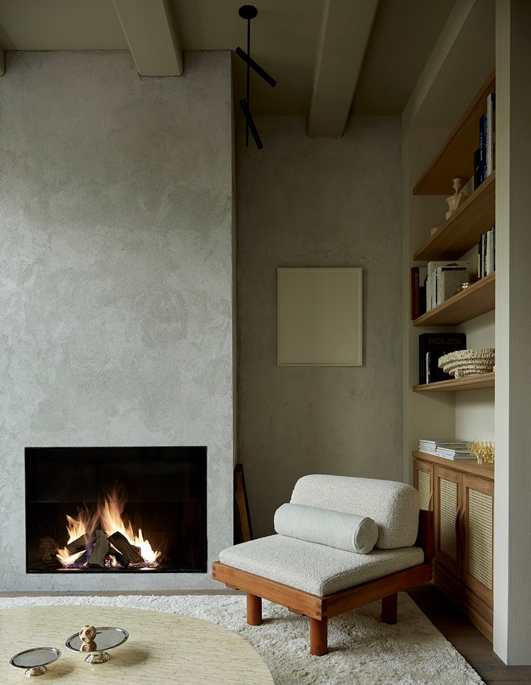 You can also see a built-in fireplace and bult-in shelves for displaying