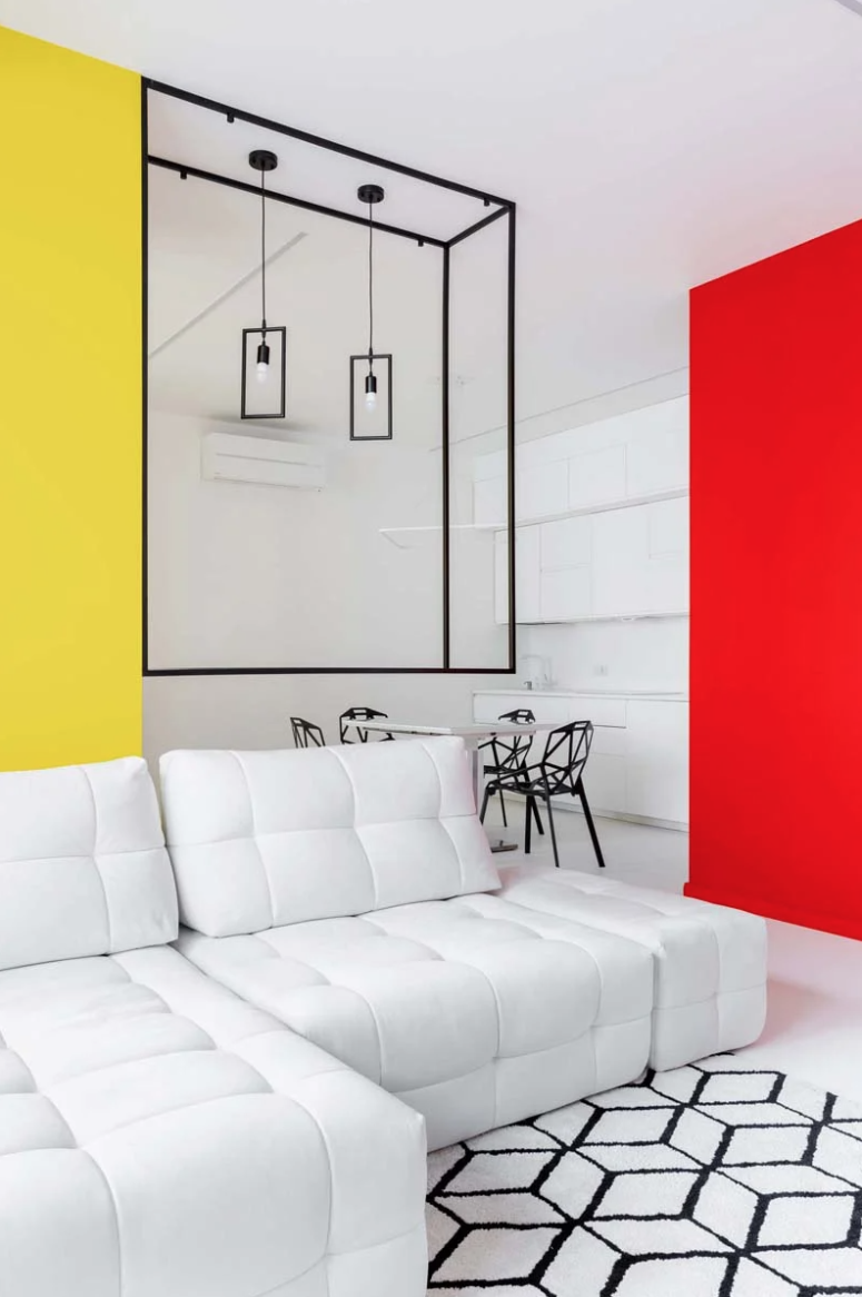 The main layout is an open space with again black and white decor and super bright colorful touches