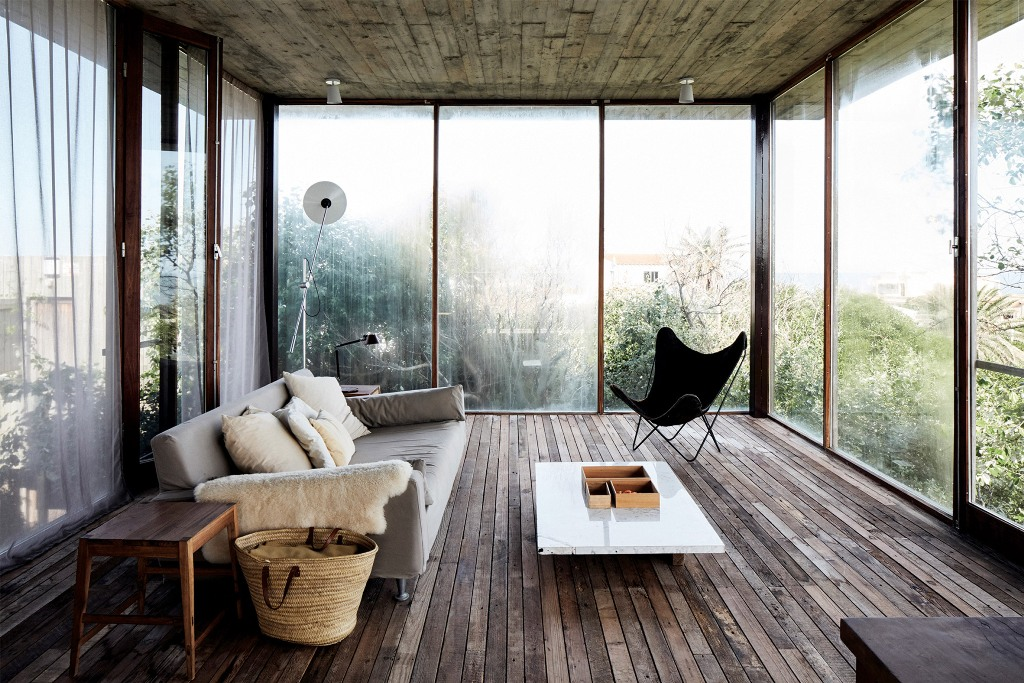 The second living room features amazing views and chic modern furniture