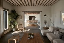 06 There's an indoor living room with wooden and upholstered furniture