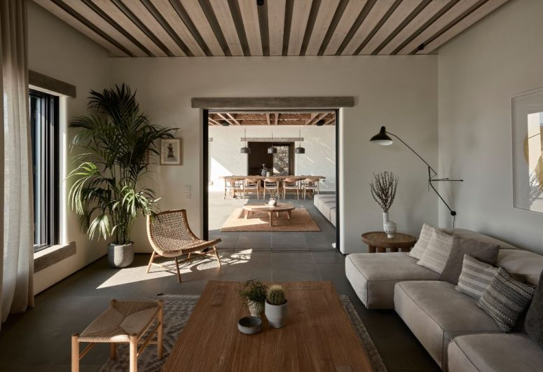 There's an indoor living room with wooden and upholstered furniture