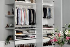 06 a stylish small built-in closet with shelves up and down and some holders for clothes hangers is a perfect idea