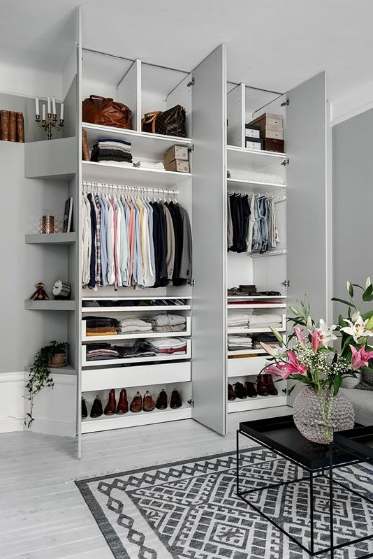 a stylish small built-in closet with shelves up and down and some holders for clothes hangers is a perfect idea