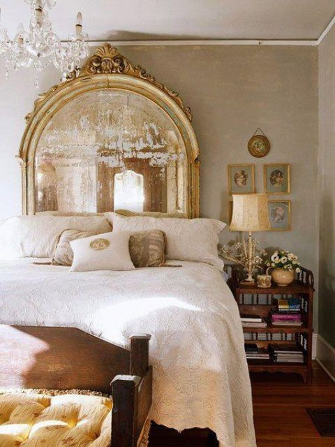 a vintage statement mirror in a refined gold frame will add an exquisite feel and a chic touch to your bedroom