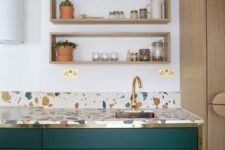 06 hunter green kitchen cabinets accented with gold touches and with bright terrazzo countertops are very chic and bold