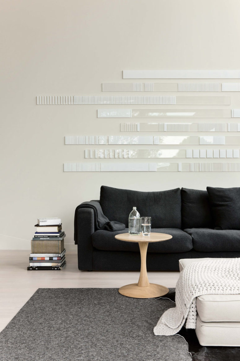 I'm totally in love with this amazing white minimalist wall art created to accent this room
