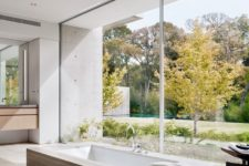 07 The bathroom features a built-in tub placed next to a glass wall to enjoy the views