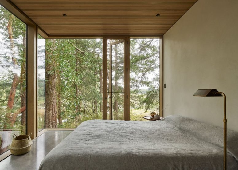 The bedroom shows off amazing views and simple modern furniture