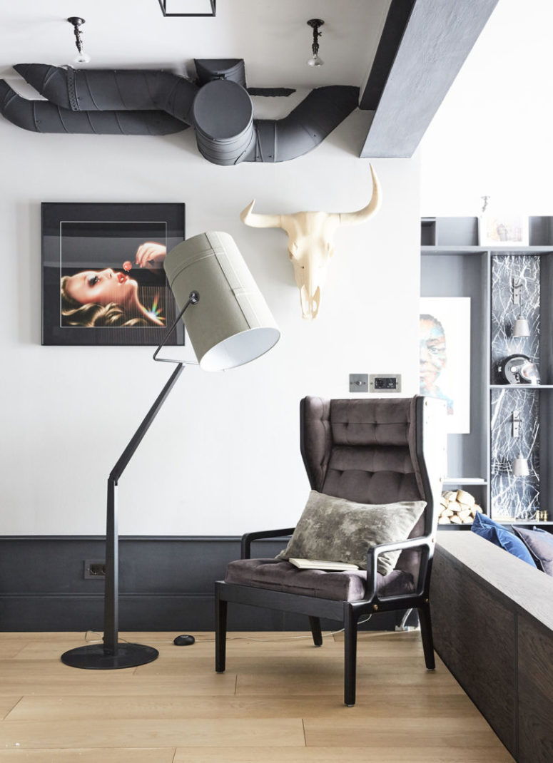 The exposed pipes, industrial lamps and cool industrial touches make the spaces look stylish