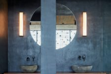 concrete looks great in an industrial bathroom