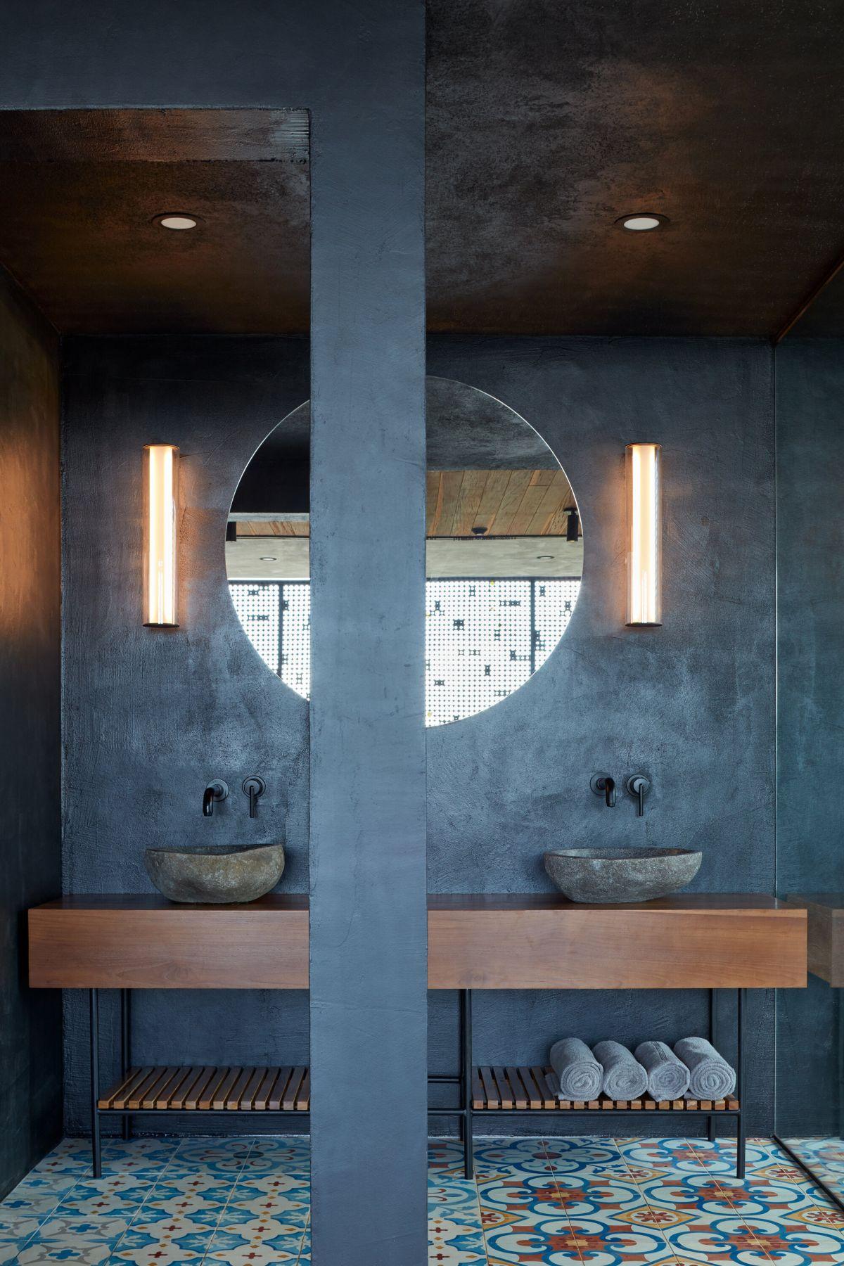 concrete looks great in an industrial bathroom