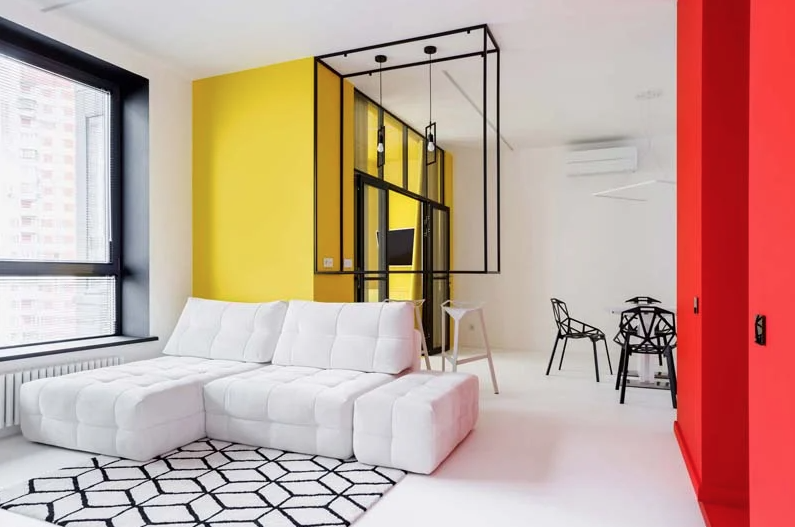 This is a block with a bright yellow bedroom and a red entryway block