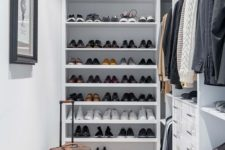 07 a small and stylish manly closet in white, with lots of open shoe shelves, holders with hangers, built-in drawers and lights