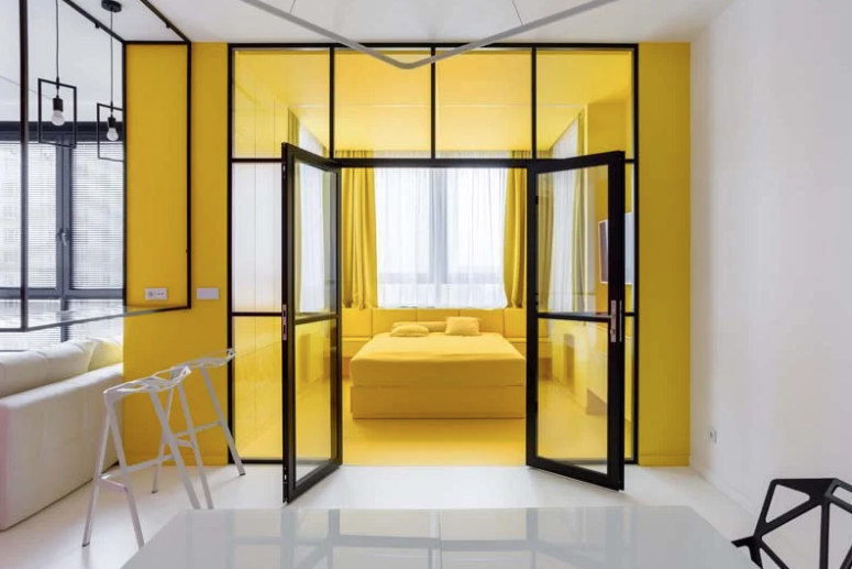 The bedroom is done bright yellow to forget about dull grey weather outdoors that often happens here