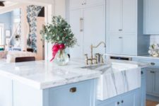 08 a beautiful and elegant light blue kitchen with white marble countertops that make a luxurious statement accenting the colors