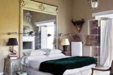 08 an eclectic bedroom with an oversized mirror in a vintage frame and some shabby chic furniture that make the space refined
