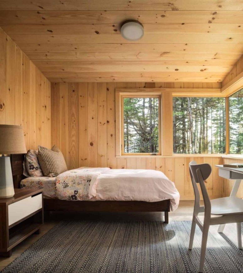 The master bedroom is done with mid-century modern furniture and several windows to enjoy the views