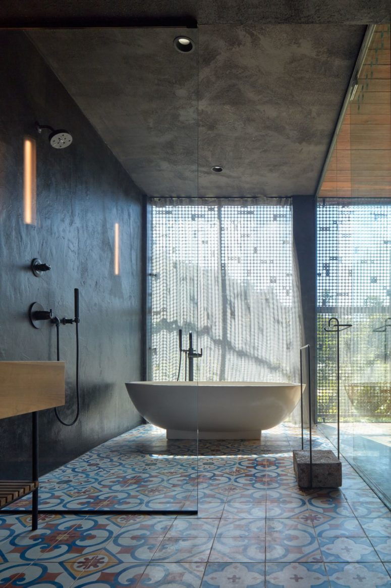 There's a bathtub and a cool view covered only with a metal screen