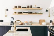 09 a black wooden kitchen highlighted with earthy-colored marble countertops including a waterfall one that make a real statement