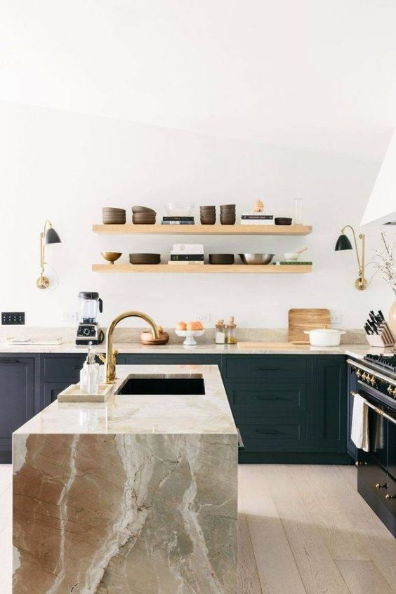 a black wooden kitchen highlighted with earthy-colored marble countertops including a waterfall one that make a real statement