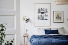 09 a gallery wall with various artworks is a cool idea for a contemporary bedroom, who needs a headboard