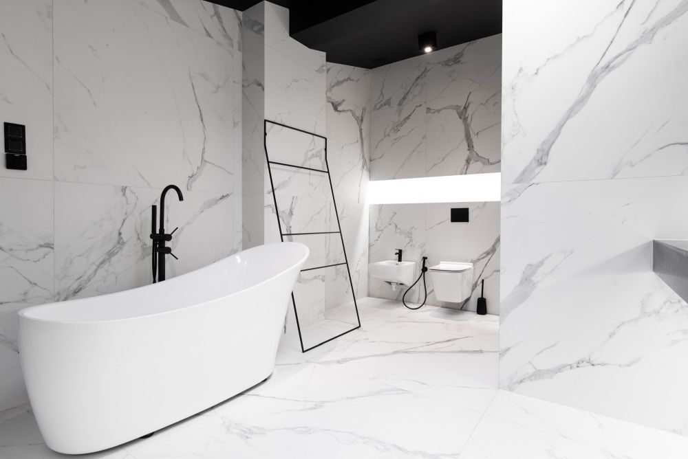 The bathroom is clad with large scale marble tiles, everything is very minimal and refined here