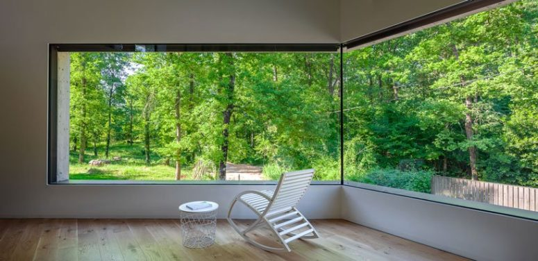 The views from the house are amazing and fresh, glazed walls allow a lot of greenery and much natural light