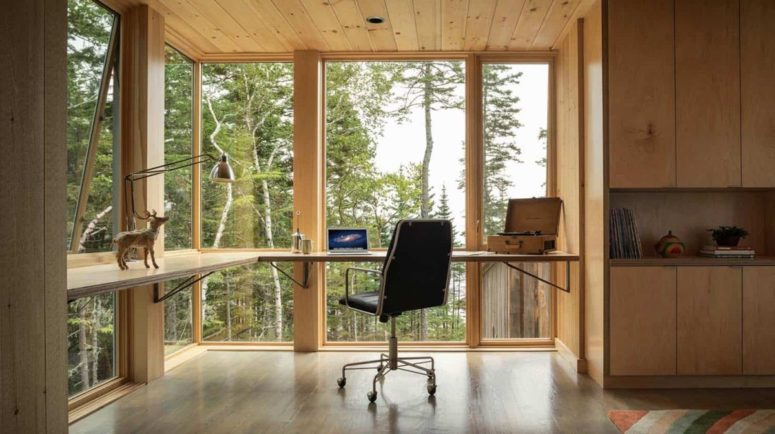This modern floating desk takes full advantage of the floor-to-ceiling windows and the abundance of natural light