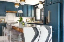10 a chic blue kitchen and a kitchen island with a gorgeous white marble waterfall countertop that makes a statement here