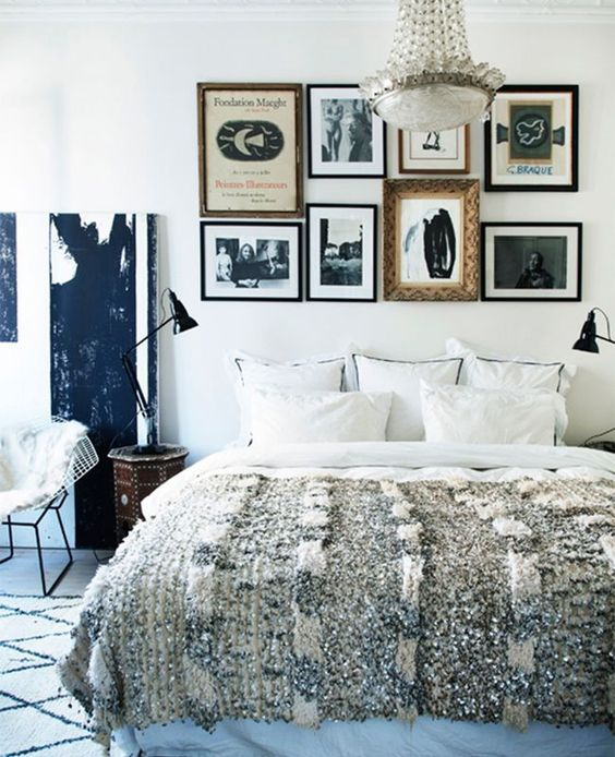 a gallery wall instead of a usual headboard is a catchy and bold idea to rock in your bedroom and personalize it a lot