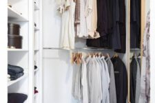 10 a small contemporary closet with holders for hangers, open shelves for various stuff, a basket and a large mirror
