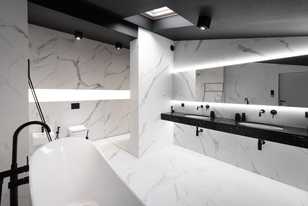 The double vanity is made of black stone