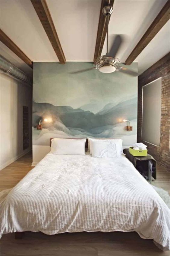 an abstract statement artwork instead of a usual headboard is a cool and chic idea that will an artsy touch to the space