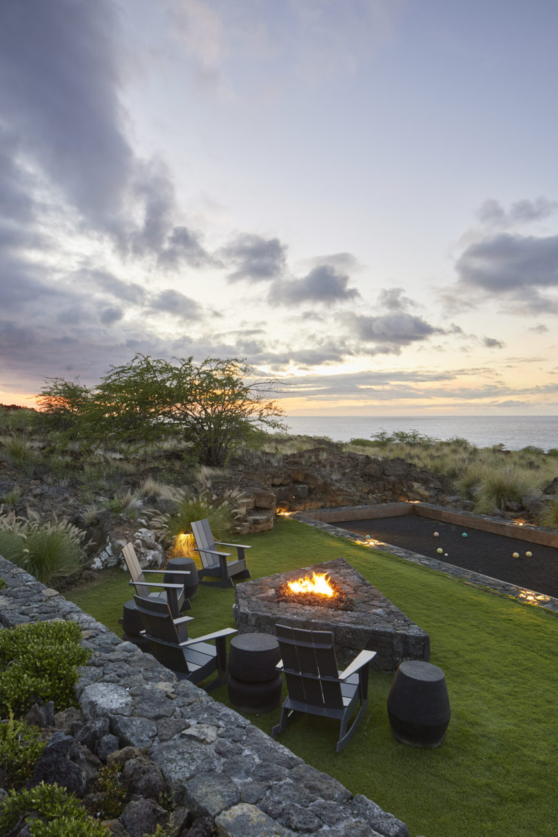 A small terrace with some chairs and a fire pit shows off amazing views