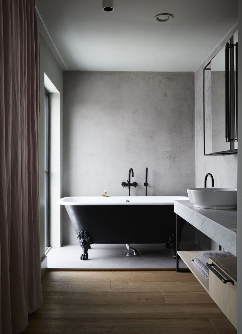The vanity is made of marble and there's a large window to enjoy light and views