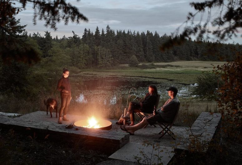 There's a terrace with a firepit and a large and forest view