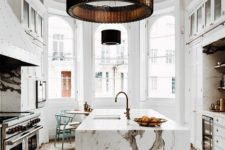 13 a luxurious white kitchen with a large kitchen island and a fantastic white marble countertop that wows at once