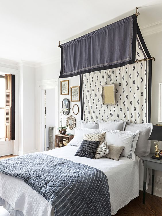 a canopy attached to the wall and ceiling and an artwork will make your bedroom refined and vintage-inspired