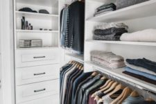 18 a small Nordic closet with open shelves, holders for clothes hangers and some built-in drawers is a cool idea