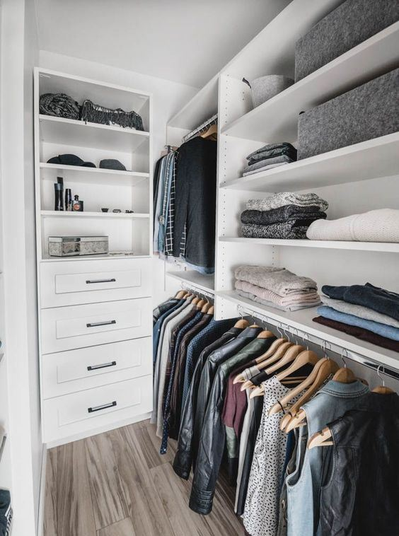 a small Nordic closet with open shelves, holders for clothes hangers and some built-in drawers is a cool idea